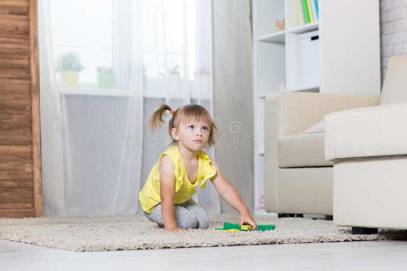 A girl of two years playing. royalty free stock images