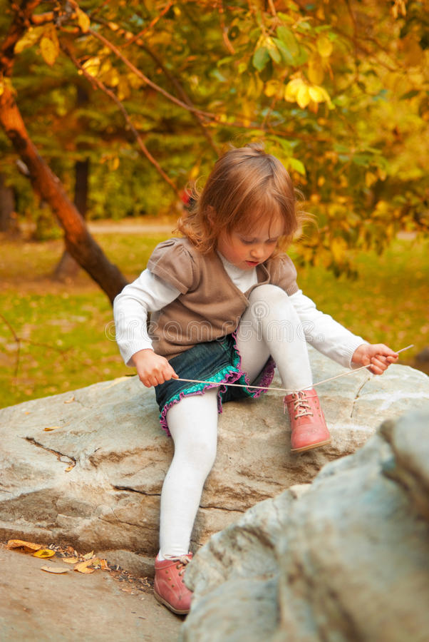 Free Girl Tying Shoelace Royalty Free Stock Photo - 16294315