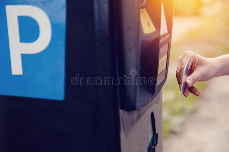 Girl types the text with her hands for making out the ticket for parking machine parking and payment for travel stock photo