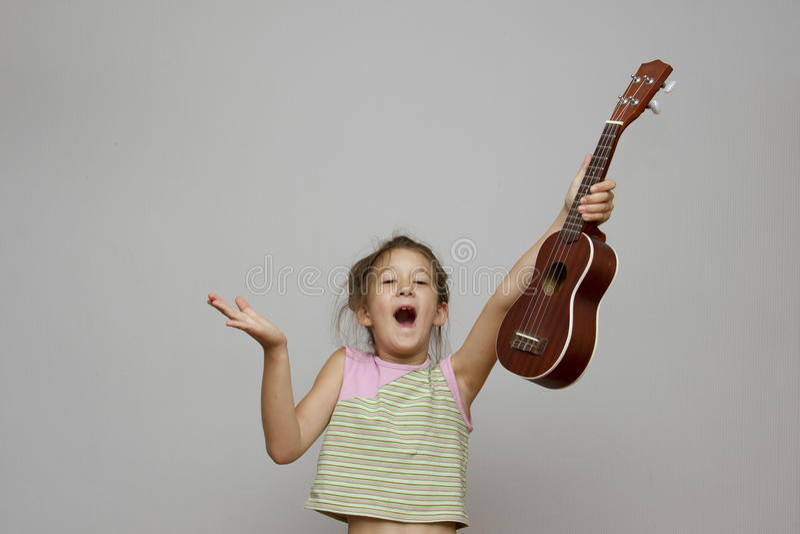 Girl with ukulele guitar royalty free stock images