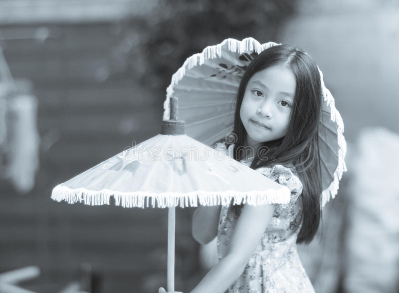 Girl with umbrella with an antique concept for imagination mess royalty free stock photography