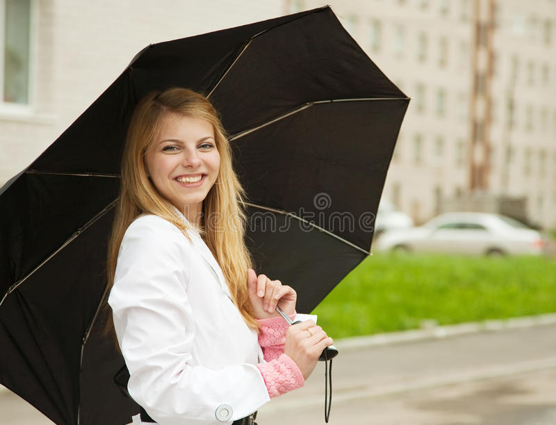 Girl with umbrella outdoors stock photo