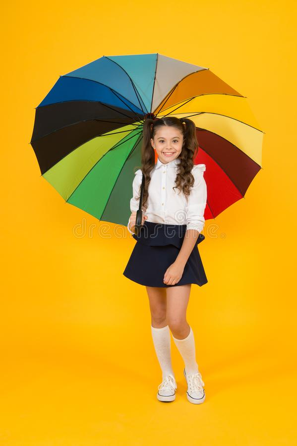 Girl with umbrella. Rainy day walks. Happy childhood. School time. Rainbow style. Colorful life. Schoolgirl happy with royalty free stock photography