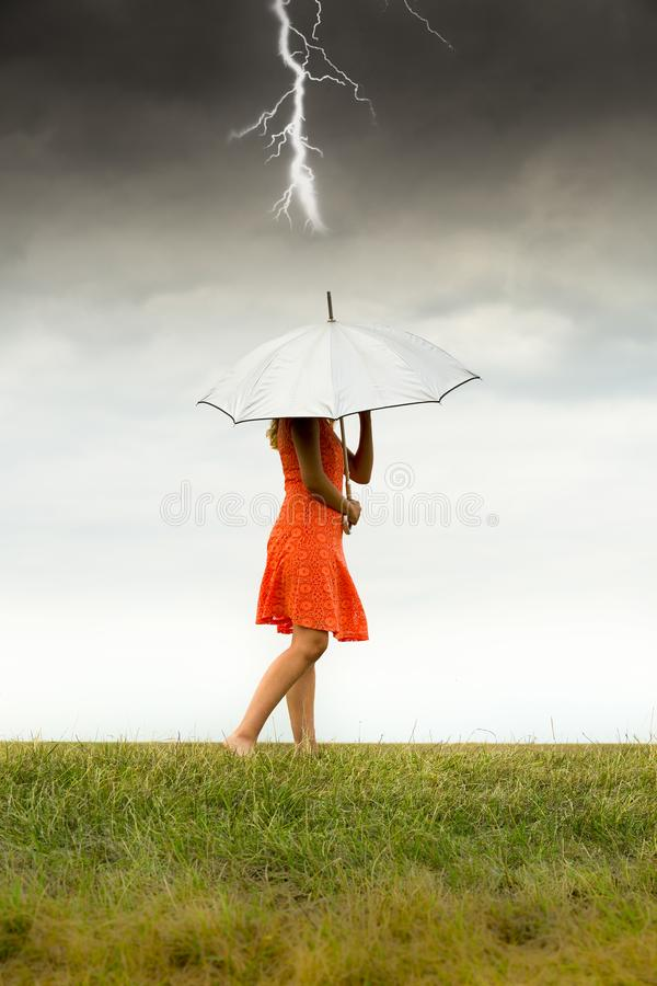 Girl with umbrella in storm royalty free stock images