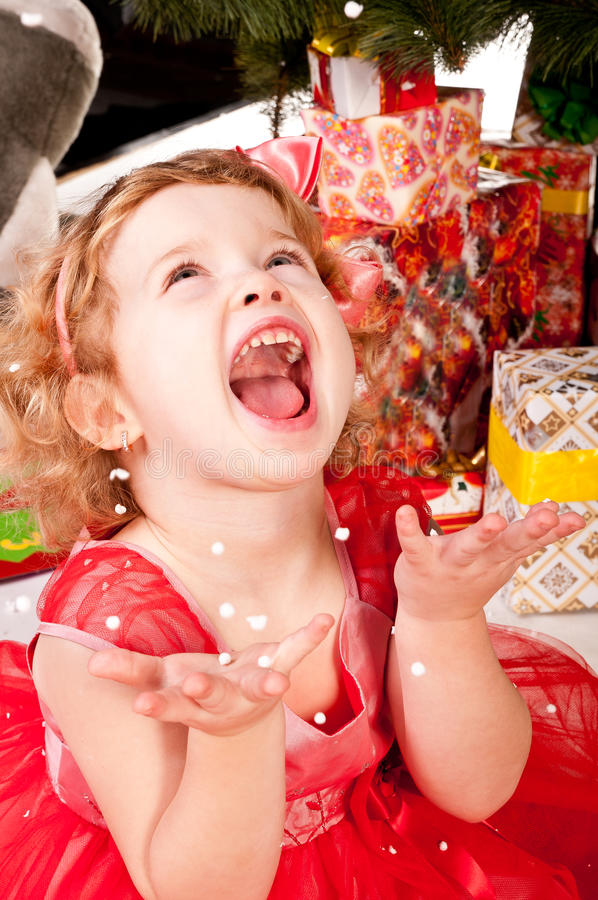 Download A Girl Under The Christmas Tree With Gifts Stock Photo - Image: 25008976