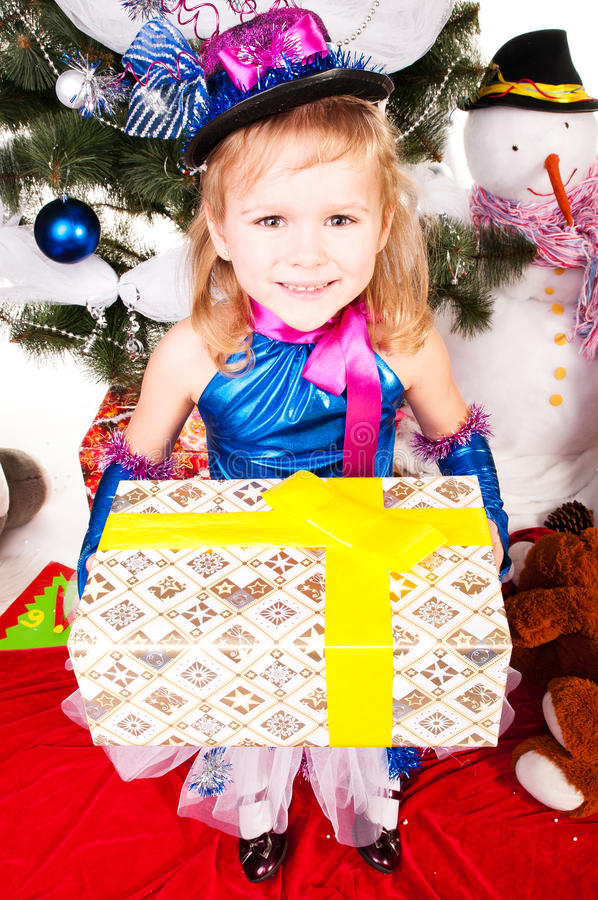 Download A Girl Under The Christmas Tree With Gifts Stock Image - Image: 25091463