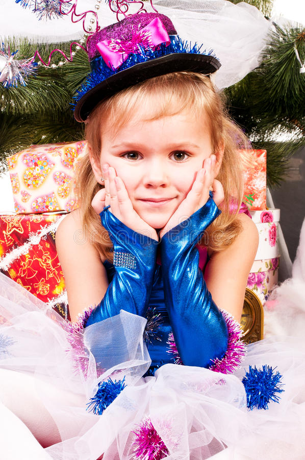 Download A Girl Under The Christmas Tree With Gifts Stock Image - Image: 25091507