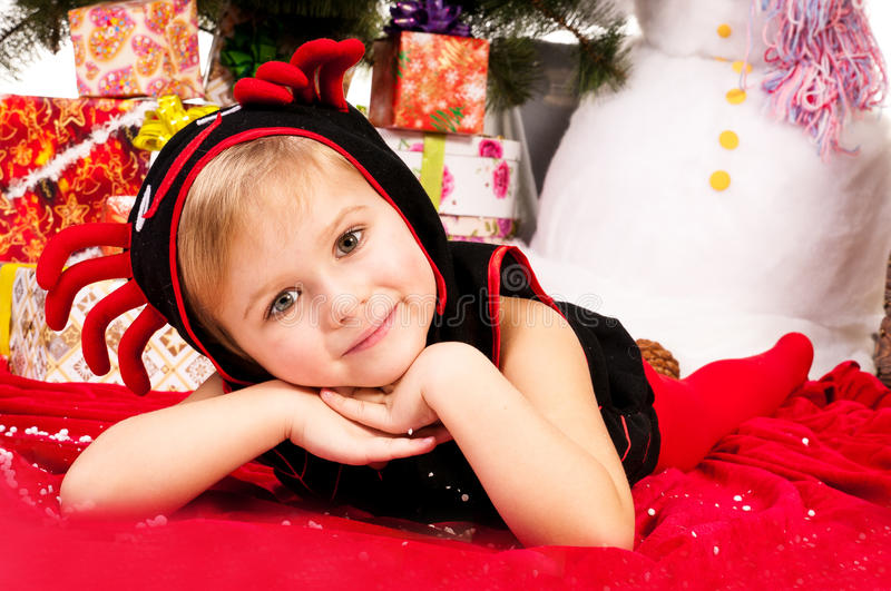 Download A Girl Under The Christmas Tree With Gifts Stock Image - Image of santa, scarf: 25118147