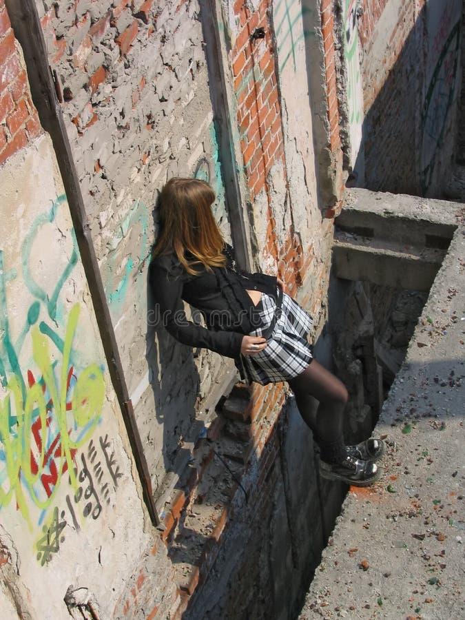 Girl under deep hole stock image