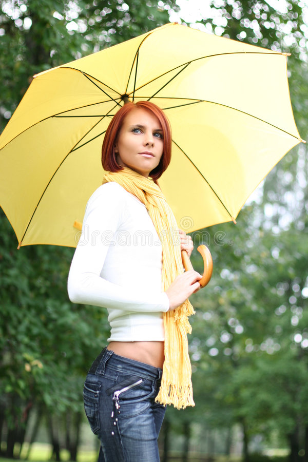 Girl under umbrella royalty free stock images