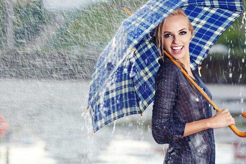 Girl Under Umbrella Watching The Rain Royalty Free Stock Image