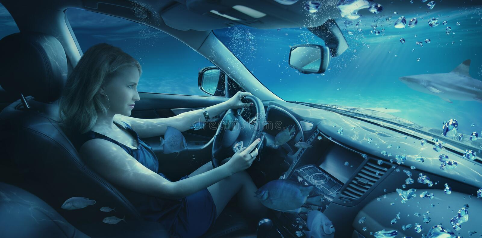 Girl underwater in the car stock photography