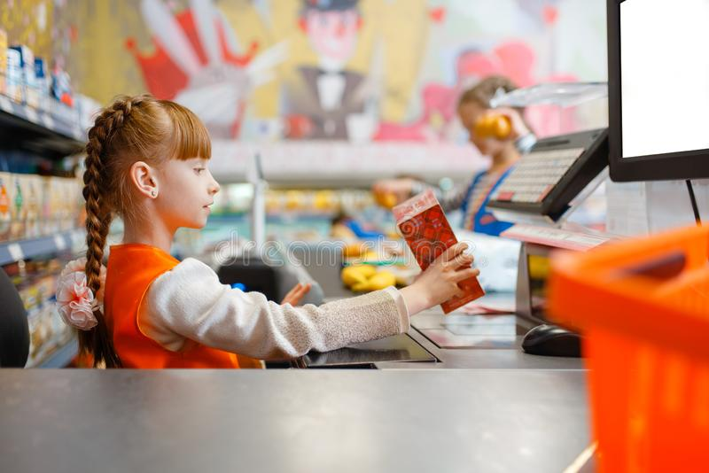 Girl in uniform at the cash register, playroom stock image
