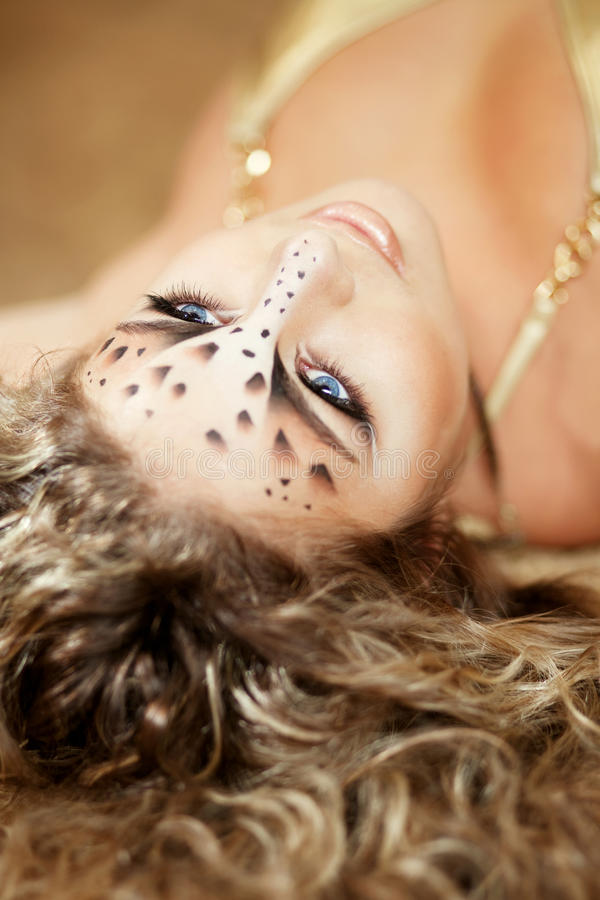 Girl with an unusual make-up as a leopard royalty free stock image