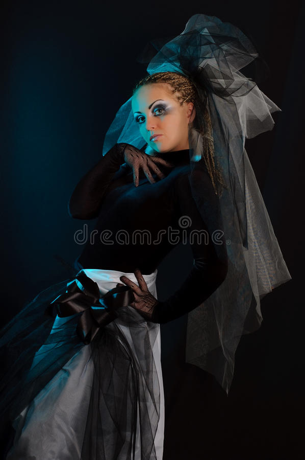 A girl with an unusual theatrical makeup stock image
