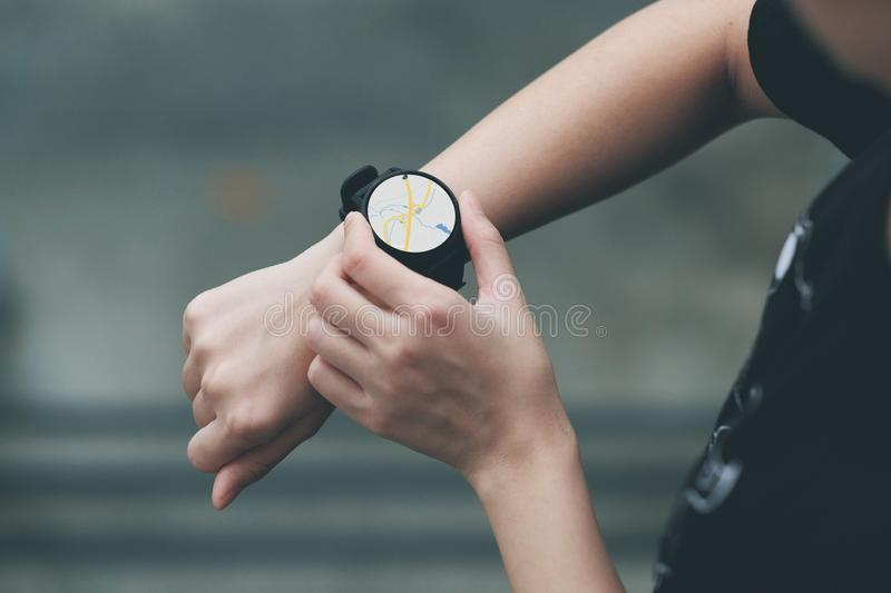 The girl uses the smart watch to see the navigation map. Smartwatch, wristwatch, touch, touchscreen, clock, gps, technology, icons, grey, closeup, display stock illustration