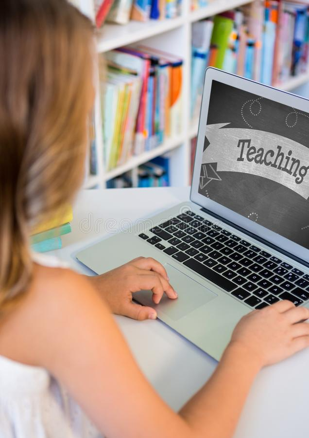 Girl using a computer with school icon on screen stock images
