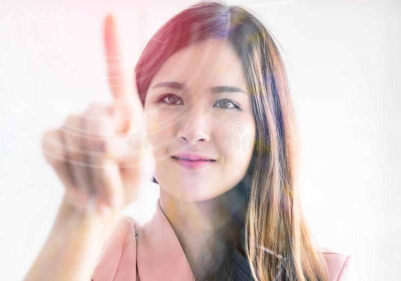 Girl using finger to touch the screen in front stock image
