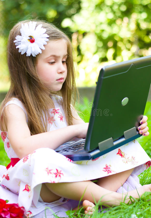 Download Girl Using Her Laptop Outdoor Stock Photo - Image: 33211034