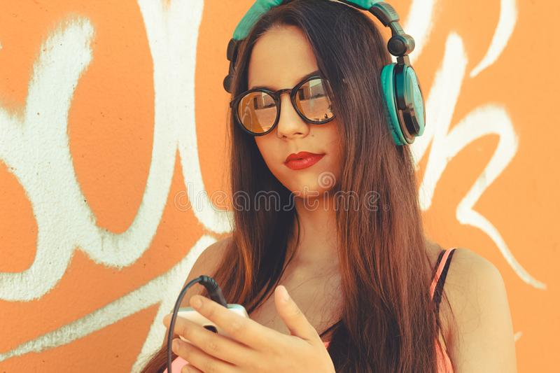 Girl using her mobile device to listen music stock image