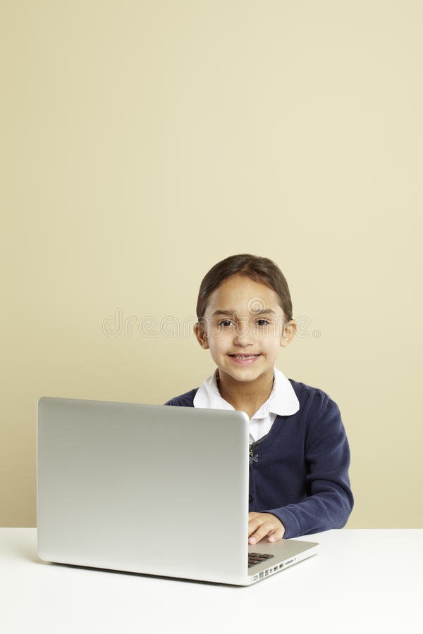 Girl using laptop royalty free stock photography