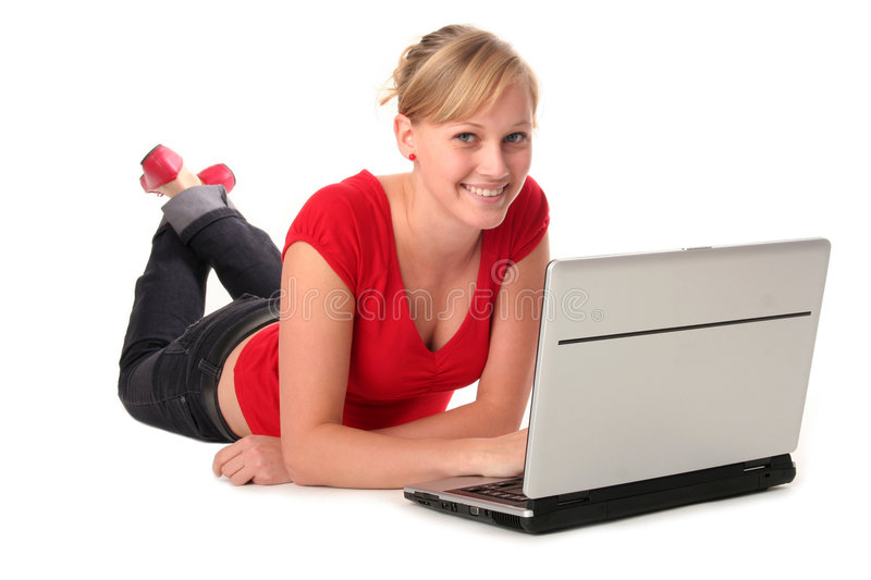 Girl using laptop. Girl lying on floor using laptop