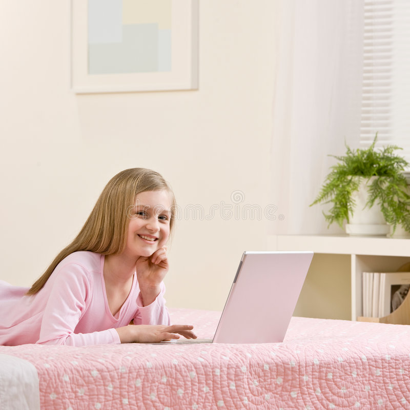 Download Girl Using Laptop For The Internet In Her Bedroom Stock Photo - Image: 6581416