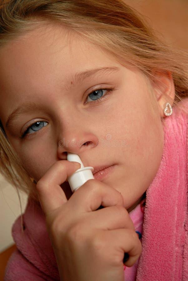 Download Girl using nasal spray stock image. Image of medicine - 14127249