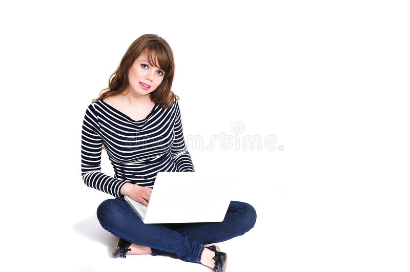 Girl using notebook stock images