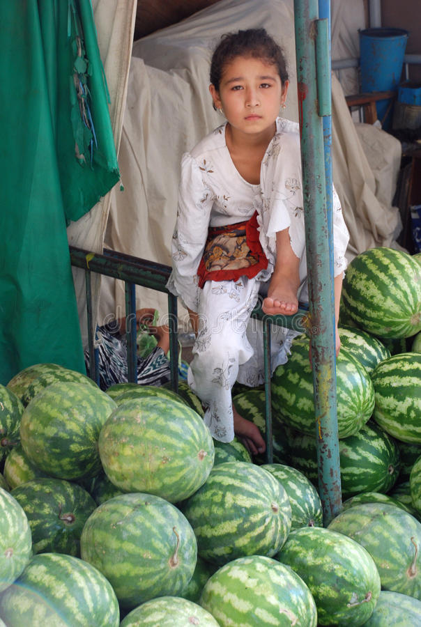Girl - Uzbek watermelons stock photography