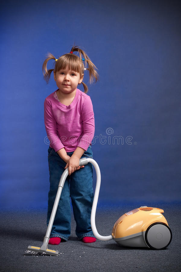 Girl with vacuum cleaner royalty free stock photos