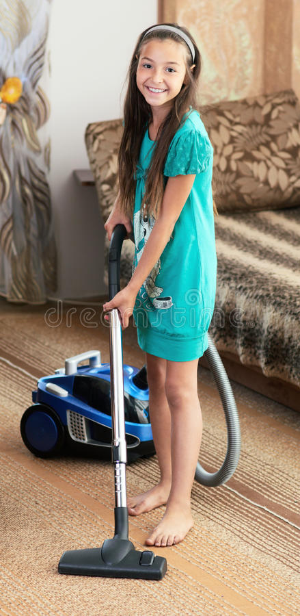 The Girl Is Vacuuming Royalty Free Stock Image Image