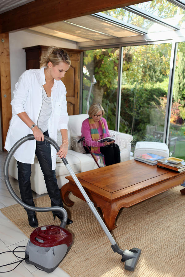 Girl vacuuming royalty free stock images