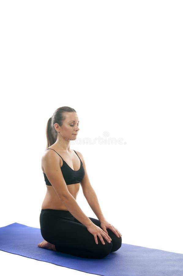 Girl in Vajrasana Pose, asana. Yoga seria: Vajrasana, Adamantine Pose, Diamond Pose, Kneeling Pose, Pelvic Pose, and Thunderbolt Pose is an asana stock images