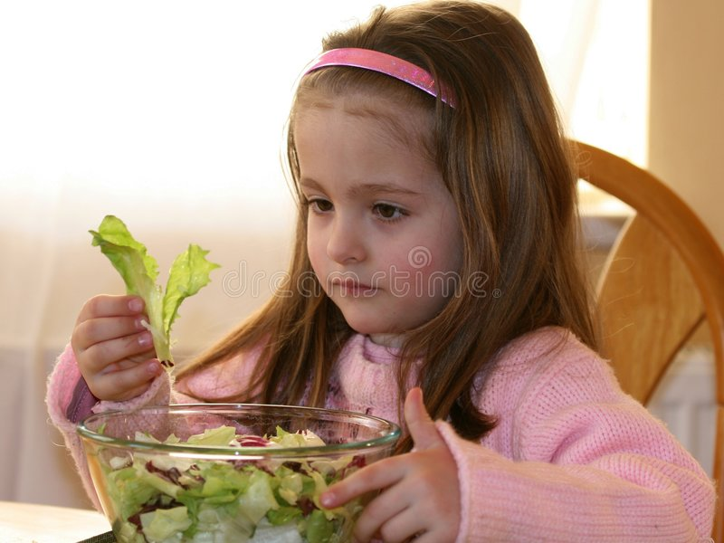 Girl and vegetables 3 stock image