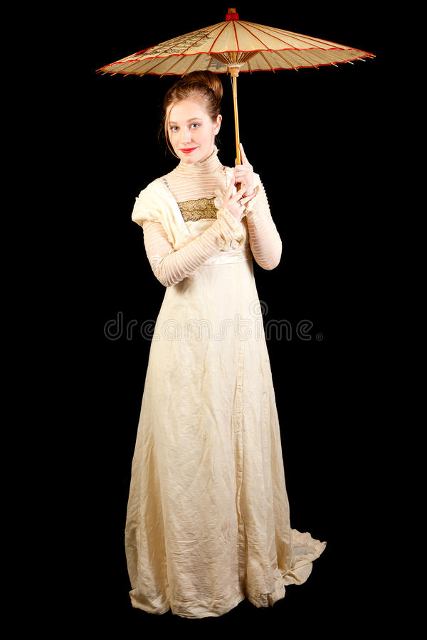 Girl in Victorian dress holding a Chinese umbrella royalty free stock photos