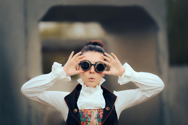 Surprised Sci Fi Retro Futuristic Steampunk Cosplay Woman. Girl in Victorian fashion style costume wearing goggles royalty free stock photography