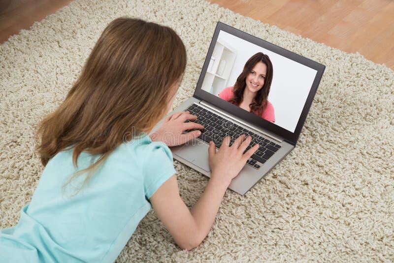 Girl Video Chatting On Laptop stock photos
