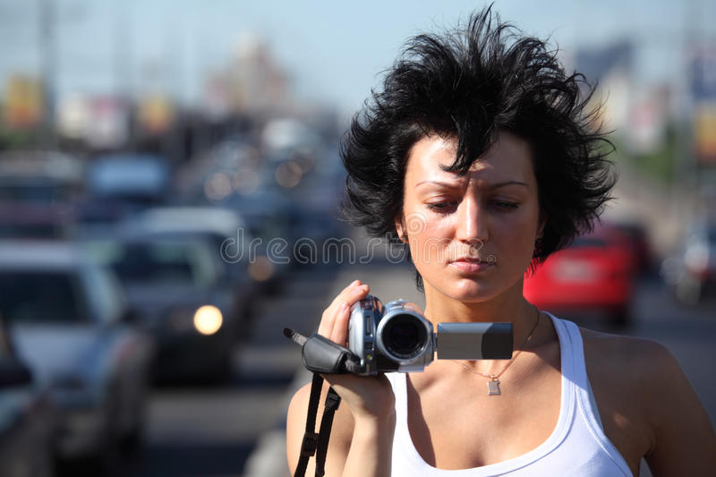 Girl With Videocamera On Highway Royalty Free Stock Image