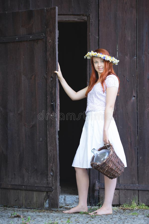 A girl from the village with a wicker basket royalty free stock photography