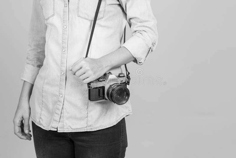 Girl with vintage analog camera. Black and white. Copy space. Girl with vintage analog camera. Black and white royalty free stock images