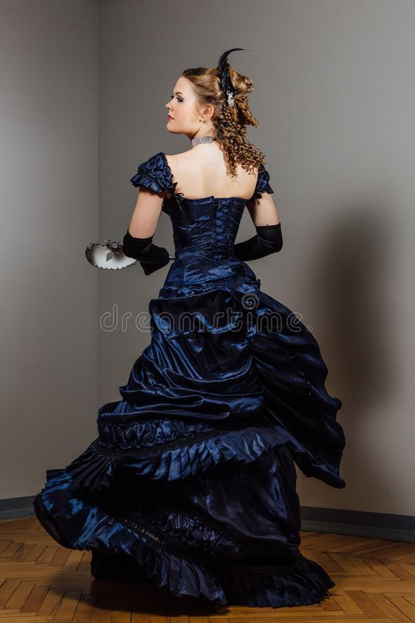 Download Girl In Vintage Blue Dress With Mask In Hands. Actress In The Role. Actor`s Game. Stock Image - Image of holiday, creativity: 114002773