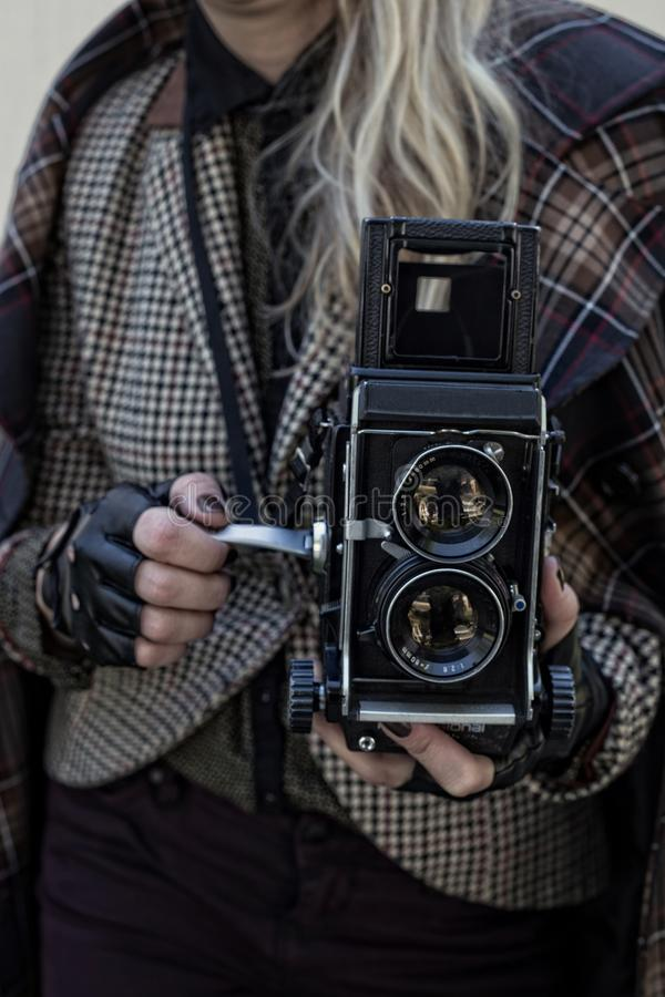 Girl in vintage clothes with old camera royalty free stock images