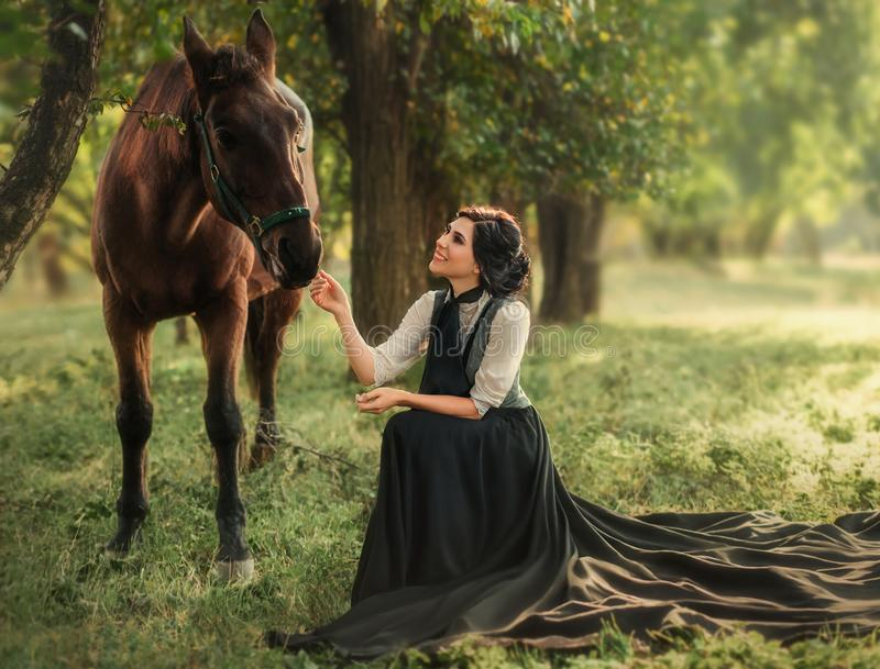 A girl in a vintage dress royalty free stock image