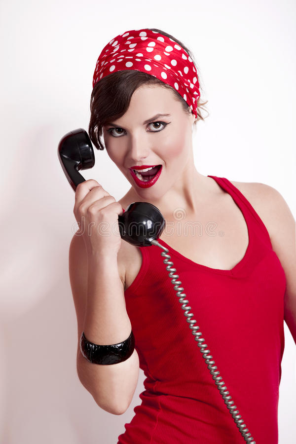 Girl with a vintage phone stock photography