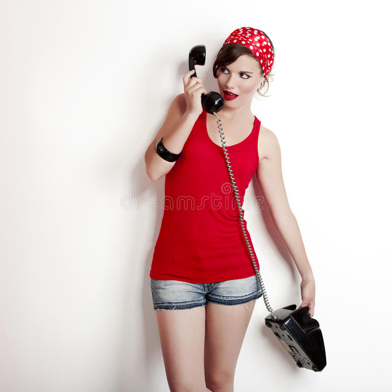 Girl with a vintage phone stock images