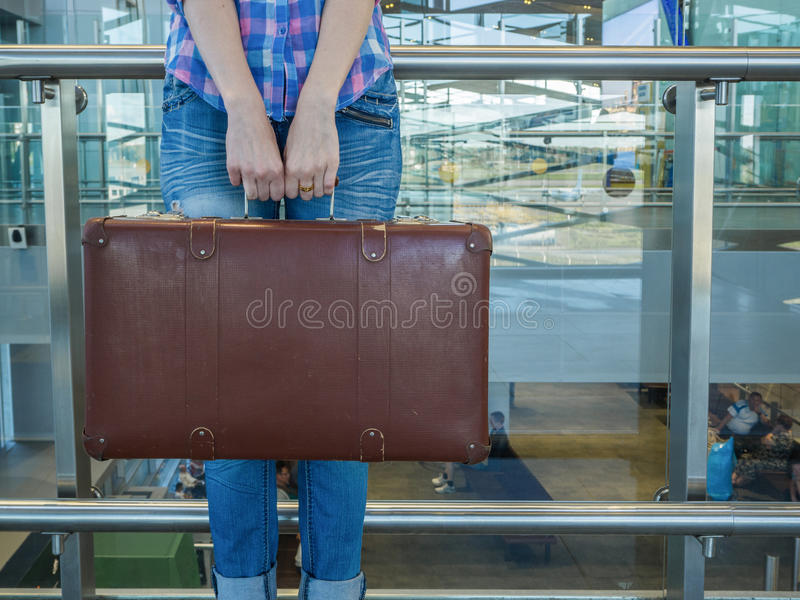 Girl with vintage retro suitcase. Glass fences. airport Terminal royalty free stock photos