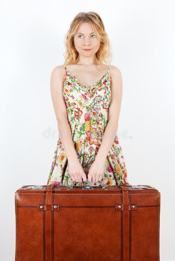 Girl with vintage suitcase anticipating travel royalty free stock images