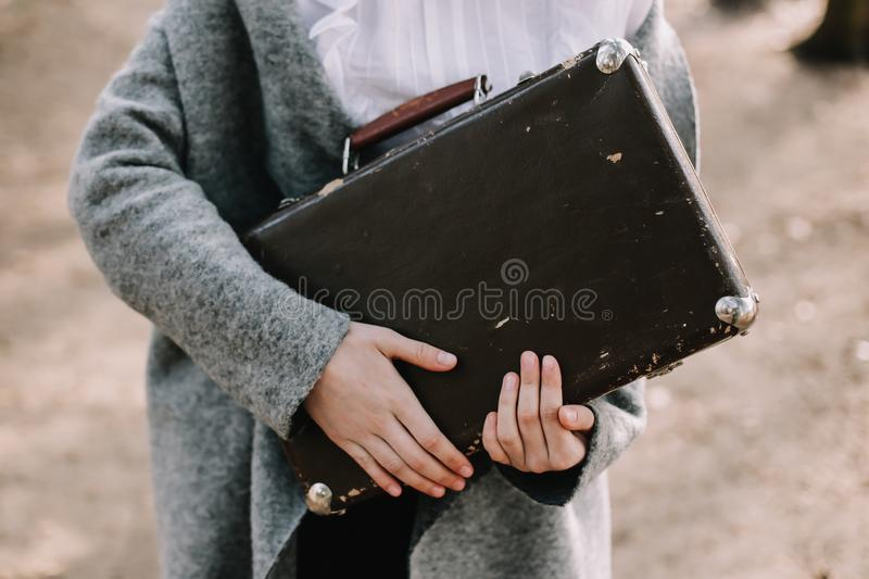 Girl with a vintage suitcase. Traveler with retro luggage. Travel concept. Girl holding a vintage suitcase. Traveler with retro luggage. Travel concept stock images