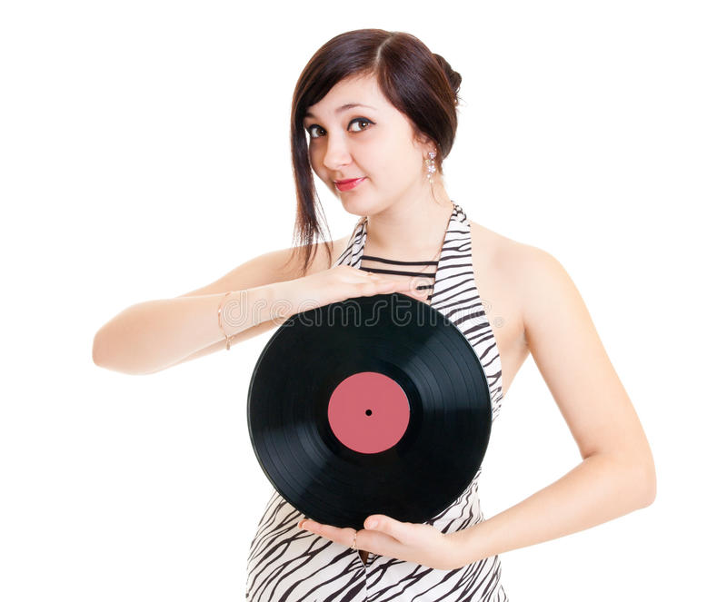 Girl with vinyl. Attractive girl showing a vinyl disc stock photo